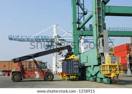 truck loading container to crane