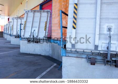 Truck loading docks at commercial building. Overhead door, dock leveler, and dock seals Сток-фото ©