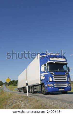 truck, lorry, blue and white in countryside
