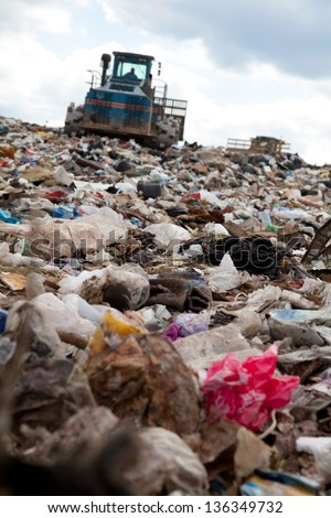 Truck moving garbage in a landfill site