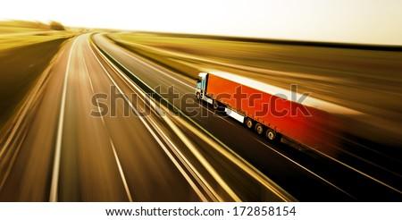 Truck on asphalt road motion blur