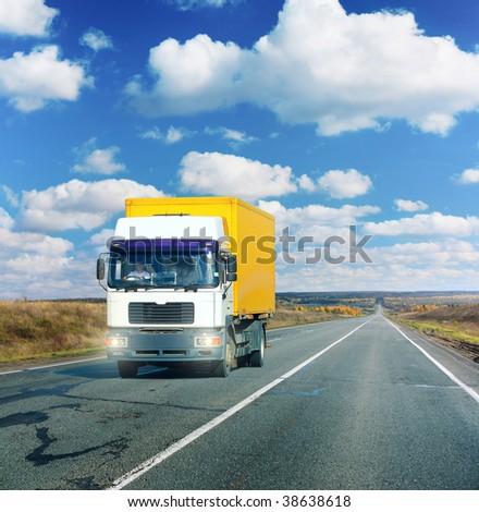 Truck on asphalt road under blue sky with clouds #38638618