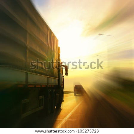 Truck on blurry road