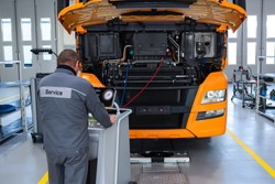 Truck on computer diagnostics in a car service. Service and repair of trucks in a large garage. Car service, repair, logistics and transport.