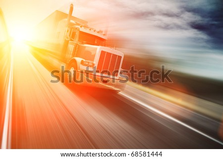 Truck on freeway at sunset. Copyspace.