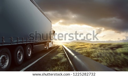 Truck on highway in the sunset