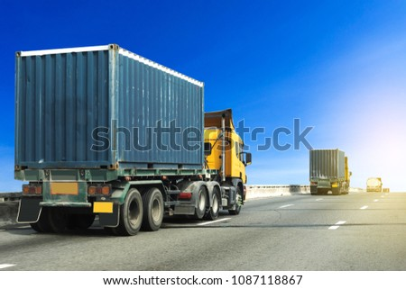 Truck on highway road with blue container, transportation concept.,import,export logistic industrial Transporting Land transport on asphalt expressway with blue sky #1087118867