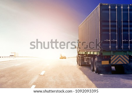 Truck on highway road with blue container, transportation concept.,import,export logistic industrial Transporting Land transport on asphalt expressway with Sun light