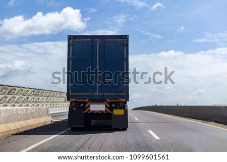 Truck on highway road with blue container, transportation concept.,import,export logistic industrial Transporting Land transport on asphalt expressway with blue sky #1099601561