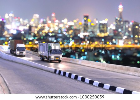 Truck on highway road with container, transportation concept.,import,export logistic industrial Transporting Land transport on the asphalt expressway with night light blurred #1030250059