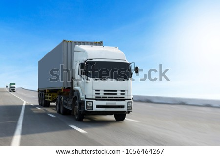 Truck on highway road with container, transportation concept.,import,export logistic industrial Transporting Land transport on the asphalt expressway.