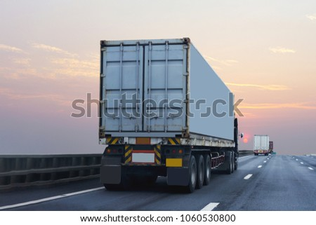 Truck on highway road with container, transportation concept.,import,export logistic industrial Transporting Land transport on the asphalt expressway with sunrise sky #1060530800