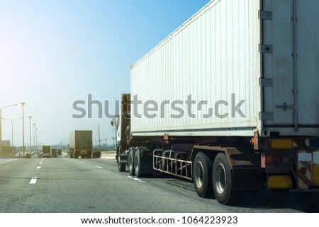 Truck on highway road with container, transportation concept.,import,export logistic industrial Transporting Land transport on asphalt expressway.with blue sky #1064223923