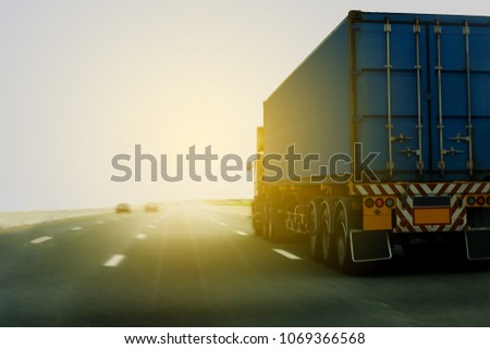Truck on highway road with container, transportation concept.,import,export logistic industrial Transporting Land transport on asphalt expressway .motion speed blurred  #1069366568