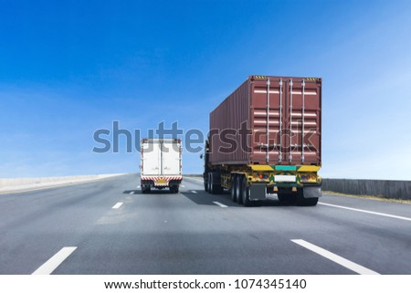 Truck on highway road with container, transportation concept.,import,export logistic industrial Transporting Land transport on asphalt expressway with blue sky #1074345140