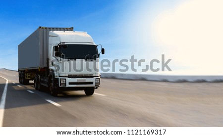 Truck on highway road with container, transportation concept.,import,export logistic industrial Transporting Land transport on asphalt expressway with blue sky #1121169317