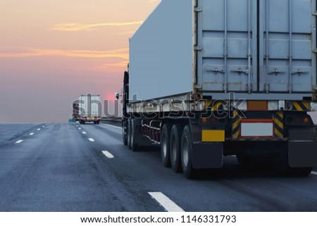 Truck on highway road with container, transportation concept.,import,export logistic industrial Transporting Land transport on the asphalt expressway with sunrise sky #1146331793