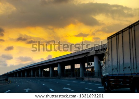 Truck on highway road with container, transportation concept.,import,export logistic industrial Transporting Land transport on asphalt expressway with sunrise sky #1331693201