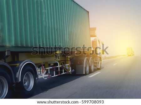 Truck on highway road with green container,transport on the expressway #599708093