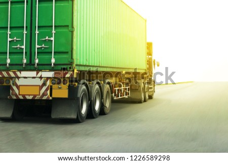 Truck on highway road with green container, transportation concept.,import,export logistic industrial Transporting Land transport on the expressway #1226589298