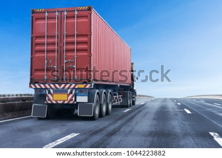 Truck on highway road with red  container, transportation concept.,import,export logistic industrial Transporting Land transport on the asphalt expressway with blue sky #1044223882