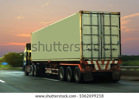 Truck on highway road with red  container, transportation concept.,import,export logistic industrial Transporting Land transport on the asphalt expressway with sunrise sky #1062699218