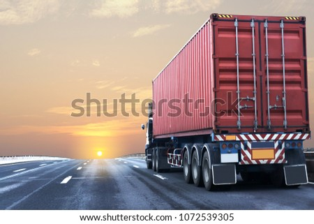 Truck on highway road with red  container, transportation concept.,import,export logistic industrial Transporting Land transport on the asphalt expressway with sunrise sky #1072539305
