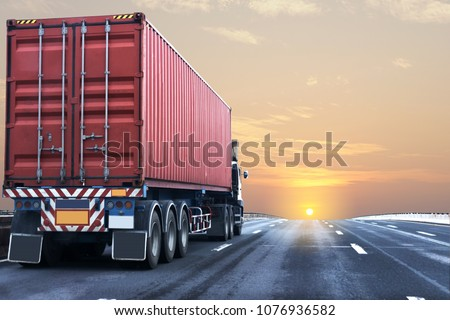 Truck on highway road with red  container, transportation concept.,import,export logistic industrial Transporting Land transport on the asphalt expressway with sunrise sky #1076936582