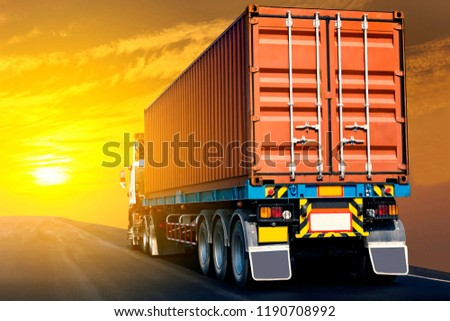 Truck on highway road with red  container, transportation concept.,import,export logistic industrial Transporting Land transport on the asphalt expressway with sunrise sky #1190708992