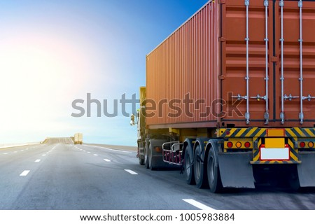 Truck on highway road with red container, transportation concept.,import,export logistic industrial Transporting Land transport on the asphalt expressway with blue sky #1005983884