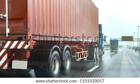 Truck on highway road with red container, transportation concept.,import,export logistic industrial Transporting Land transport on rain is falling on the asphalt road.