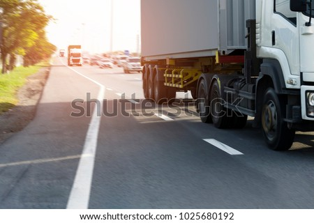 Truck on road container motion blurry, transportation concept.,import,export logistic industrial Transporting Land transport on the asphalt expressway #1025680192