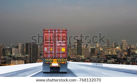 Truck on road container, transportation concept.,import,export logistic industrial Transporting Land transport on the expressway driving to Night City view with cityscape