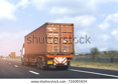 Truck on road container, transportation concept.Speed fast motion blurred Transporting Land transport on the expressway