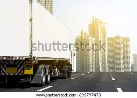Truck on road container, transportation concept. Transporting Land transport. Drive to downtown in the urban city #693797470