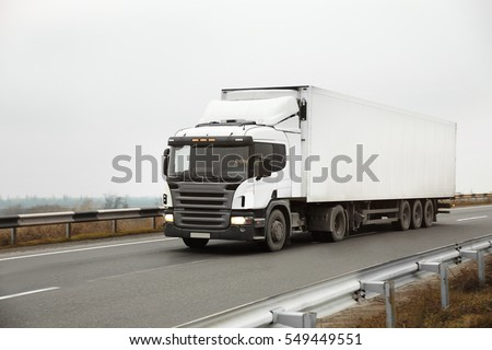 Truck on road. Delivery and shipping concept. #549449551