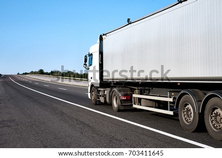Truck on road with blank container, cargo transportation concept