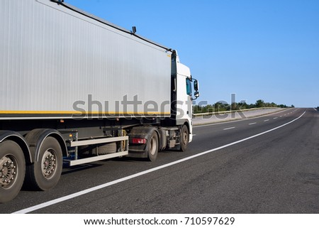 Truck on road with container, cargo transportation concept, closeup object