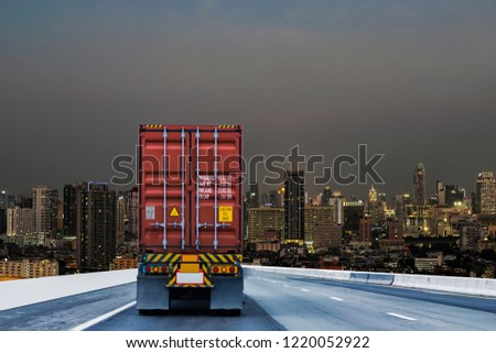 Truck on road with red container, transportation concept.,import,export logistic industrial Transporting Land transport on the expressway driving to Night City  #1220052922
