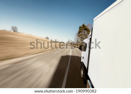 Truck on the road 3D render on photographic background