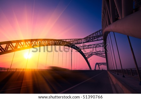 truck speeding through a bridge at sunset,motion blur. #51390766