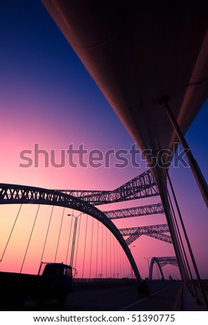 truck speeding through a bridge at sunset,motion blur.