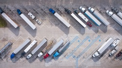 Truck stop on Rest area On the highway. Top view car parking lot. Truck Driver company. View from the bird's flight. Aerial photography.