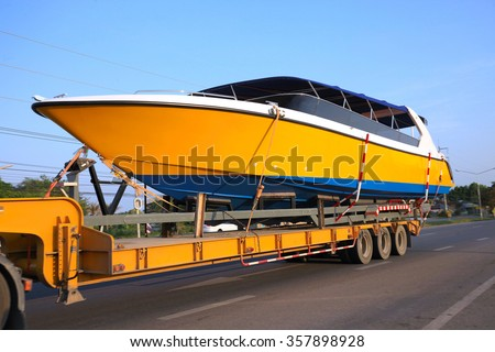 Truck Trailer Hitch speedboat on new ships. Running on the road. ( select focus )  stock photo