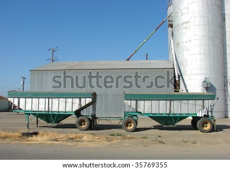 Truck trailer in front of grain silo