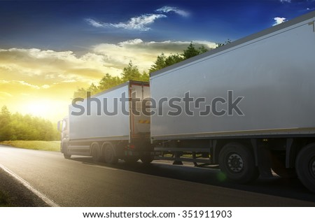 Truck trailer on the highway in a commercial trip. #351911903