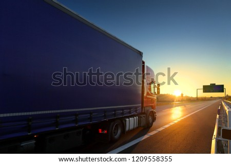 Truck transport on the road at sunset