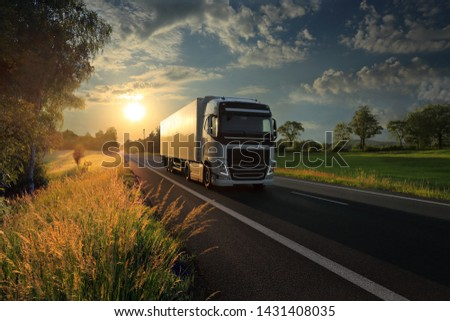 Truck transport on the road at sunset and cargo  #1431408035
