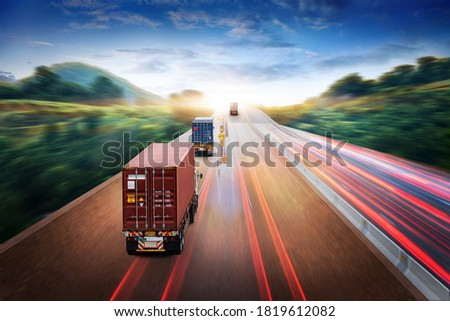 Truck transport with red container on highway road at sunset, motion blur effect, logistics import export background and cargo transport industry concept Zdjęcia stock ©