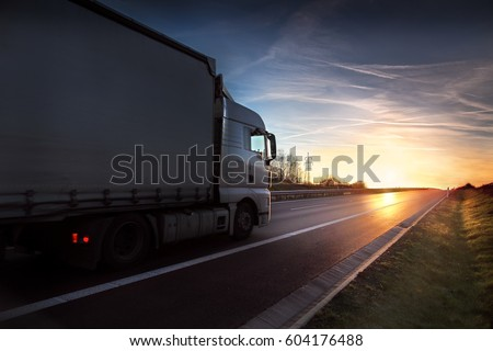 Truck transportation at sunset #604176488